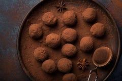 Chocolate truffles on dark blue background Royalty Free Stock Photos