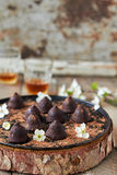 Chocolate truffles. Delicious chocolate truffles on the table Royalty Free Stock Image
