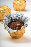 Chocolate truffles in foil wrap Stock Image