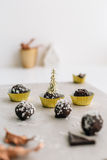 Chocolate Truffles in Gold Paper Cases on Marble Slab against White Background Royalty Free Stock Photos
