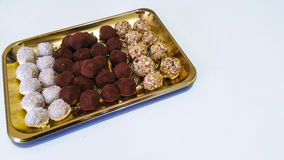 Chocolate Truffles. On a golden tray Royalty Free Stock Photo
