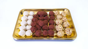 Chocolate Truffles. In a golden tray Royalty Free Stock Image