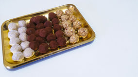 Chocolate Truffles. In a golden tray Stock Photography
