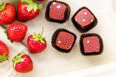 Chocolate truffles. Gourmet Strawberries and champaigne chocolate truffles Royalty Free Stock Image
