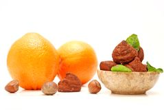 Chocolate truffles, hazelnuts and oranges Stock Photo