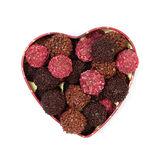Chocolate truffles in heart shaped box. On white background Royalty Free Stock Photos