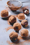 Chocolate truffles. Homemade chocolate truffles with marzipan and cocoa powder over gray matal surface stock photo