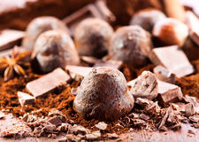Chocolate truffles. With ingredients on wooden table stock images