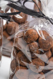 Chocolate truffles in luxury bags with focus on foreground Stock Image