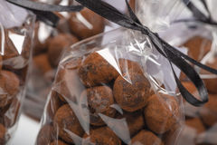 Chocolate truffles in luxury bags with focus on foreground Royalty Free Stock Photography