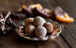 Chocolate, truffles and orange slices in dark chocolat Royalty Free Stock Photos
