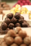 Chocolate truffles. Pile of assorted chocolate truffles with a blurry background Royalty Free Stock Photo