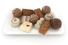 Chocolate truffles on a plate Stock Image