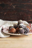 Chocolate truffles on plate Royalty Free Stock Photo