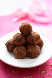 Chocolate truffles in plate Royalty Free Stock Photos