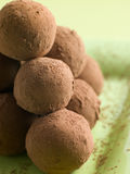 Chocolate Truffles on a plate. On top of each other royalty free stock photo