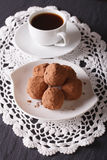 Chocolate truffles on a plate and coffee on the table. vertical Stock Image