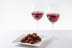 Chocolate Truffles with Red Wine. Chocolate Truffles with glass of Red Wine Royalty Free Stock Images
