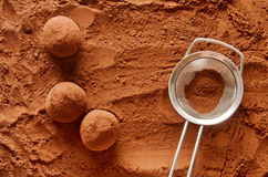 Chocolate truffles. Rolling chocolate truffles in cocoa powder stock photography