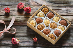 Chocolate truffles and roses Stock Photo