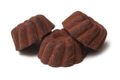 Chocolate truffles in shaped Kougelhopf on white background. Closeup of chocolate truffles in shaped Kougelhopf on white background royalty free stock photography