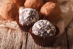 Chocolate truffles sprinkled with nuts macro. horizontal Stock Photos