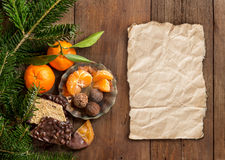 Chocolate, truffles and tangerins Stock Image
