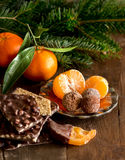 Chocolate, truffles and tangerins Stock Photos