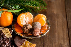 Chocolate, truffles and tangerins Stock Images