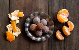 Chocolate truffles and tangerins Royalty Free Stock Photos