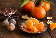 Chocolate, truffles and tangerins Royalty Free Stock Images