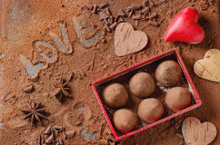 Chocolate truffles with Valentine`s hearts Stock Photo
