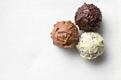 Chocolate truffles on white tablecloth. Top view of chocolate truffles on white tablecloth Stock Photos