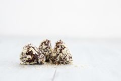 Chocolate truffles on white wooden background Royalty Free Stock Images