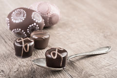 Chocolate truffles on a wooden table, text space Stock Photos