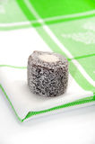 Chocolate turkish delight over green tablecloth Stock Photo
