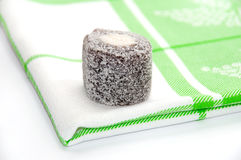 Chocolate turkish delight over green tablecloth Royalty Free Stock Photography