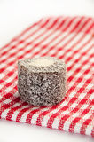Chocolate turkish delight on the red tablecloth Royalty Free Stock Photos