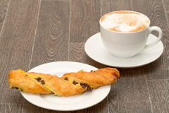 Chocolate twist pastry with a cappuccino Royalty Free Stock Photography