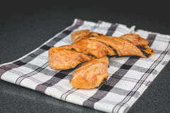 Chocolate twists on a black and white napkin Royalty Free Stock Photo