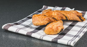 Chocolate twists on a black and white napkin Royalty Free Stock Image