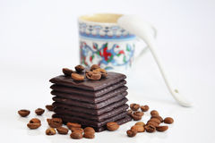 Chocolate and unfocused cup of coffee Stock Photography