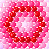 Chocolate Valentine's candy coated in pink, red and white Royalty Free Stock Photos