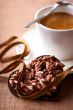 Chocolate valentine's heart and a cup of espresso Stock Photos