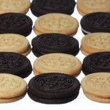 Chocolate and vanilla cookies with cream filling isolated. background Royalty Free Stock Photos