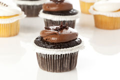 Chocolate and Vanilla Frosted Cupcake Royalty Free Stock Images