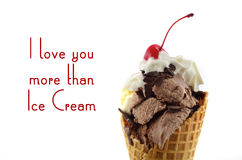 Chocolate and vanilla ice cream wafer cones. Chocolate and vanilla ice cream wafer cone with whipped cream and cherry with stem on top, with I Love You More stock photos