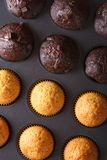 Chocolate and vanilla muffins in baking dish macro. Vertical Stock Photography