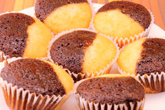 Chocolate and vanilla muffins closeup Stock Photo