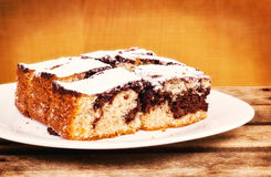 Chocolate and vanilla sponge cake served on a plate Royalty Free Stock Photography
